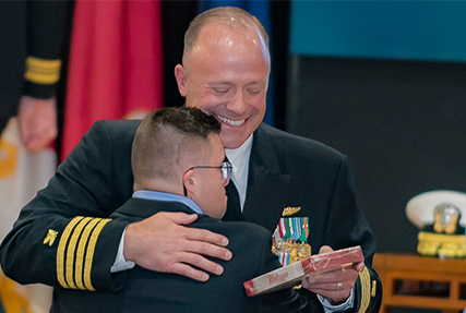 DLA Land and Maritime celebrates a quarter of a century of military service with Naval officer retirement