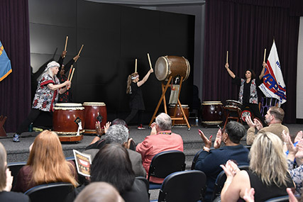 The Hart-Dole-Inouye Federal Center echoed with the booming sounds of taiko drums and shouts in Japanese as members of the workforce embraced a 2,000 year-old culture during an Asian Pacific Heritage Month program event.
