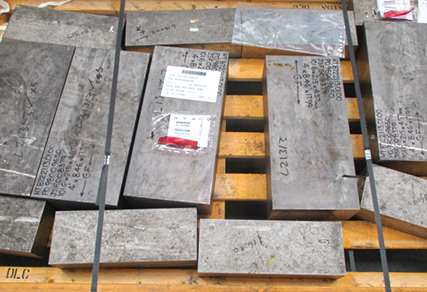 Various-sized bars of titanium on a pallet