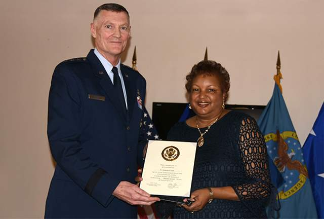Annette Fryar retires with 27 years of federal service.