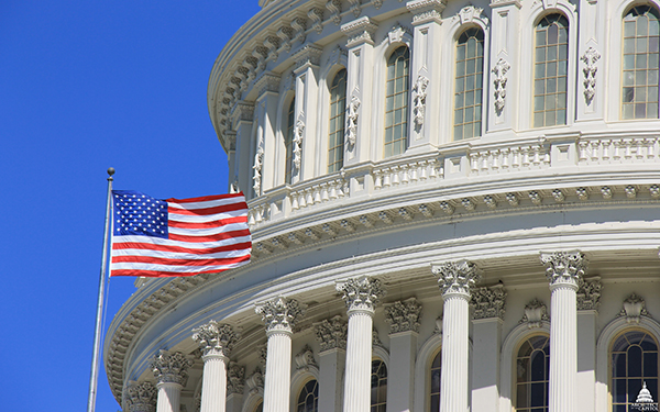 A U.S. flag flying over the Capitol