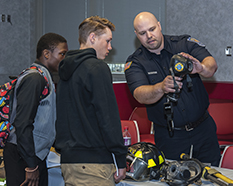 High school students learn about becoming a DoD police officer
