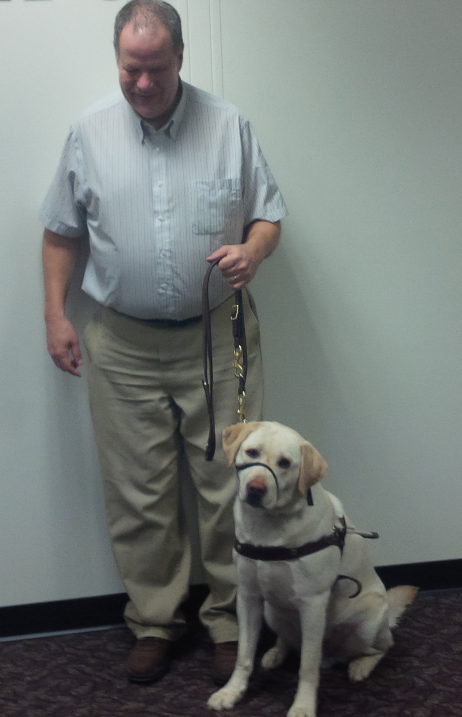 Odie the dog and Brian his handler