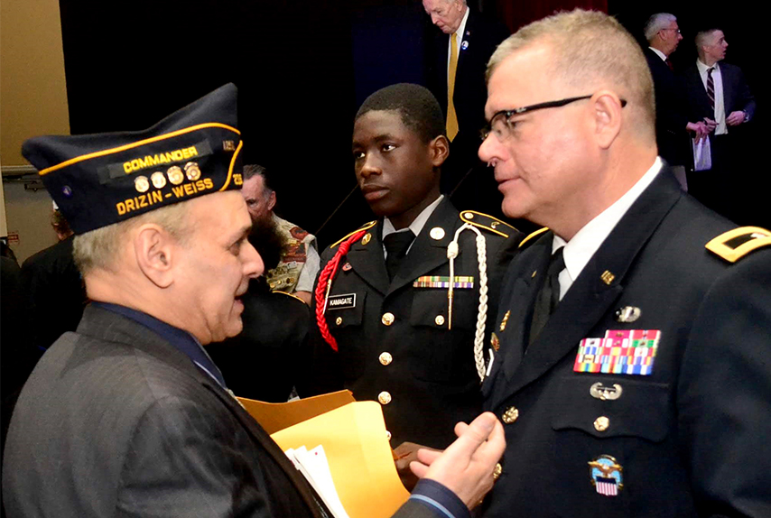 DLA Troop Support Commander Army Brig. Gen. Mark Simerly places a Vietnam Veteran Commemoration Program lapel pin on a veteran during a recognition ceremony March 29, 2019 in Philadelphia.