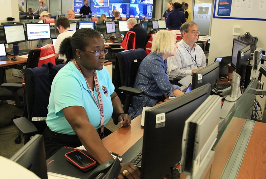 The National Response Coordination Center at FEMA in Washington D.C. is activated to respond to Hurricane Dorian. Defense Logistics Agency liaisons, pictured in the foreground, are positioned in the NRCC to aid in coordinating DLA materiel requests in support of FEMA and other whole of government partners in response and recovery efforts.