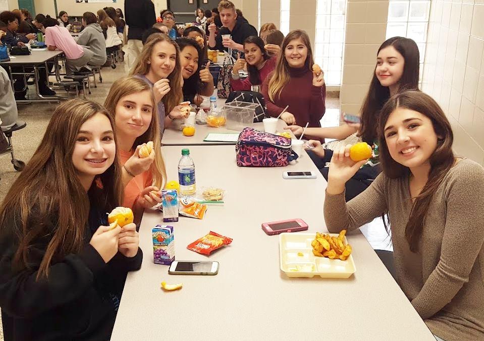 Alabama students enjoy satsumas