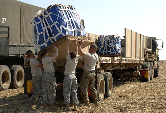 Servicemembers unload supplies. DLA strives to place the warfighter first in all it does.