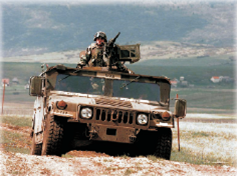 Picture of Land and Maritime employee in a combat vehicle