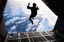 man jumping from plane