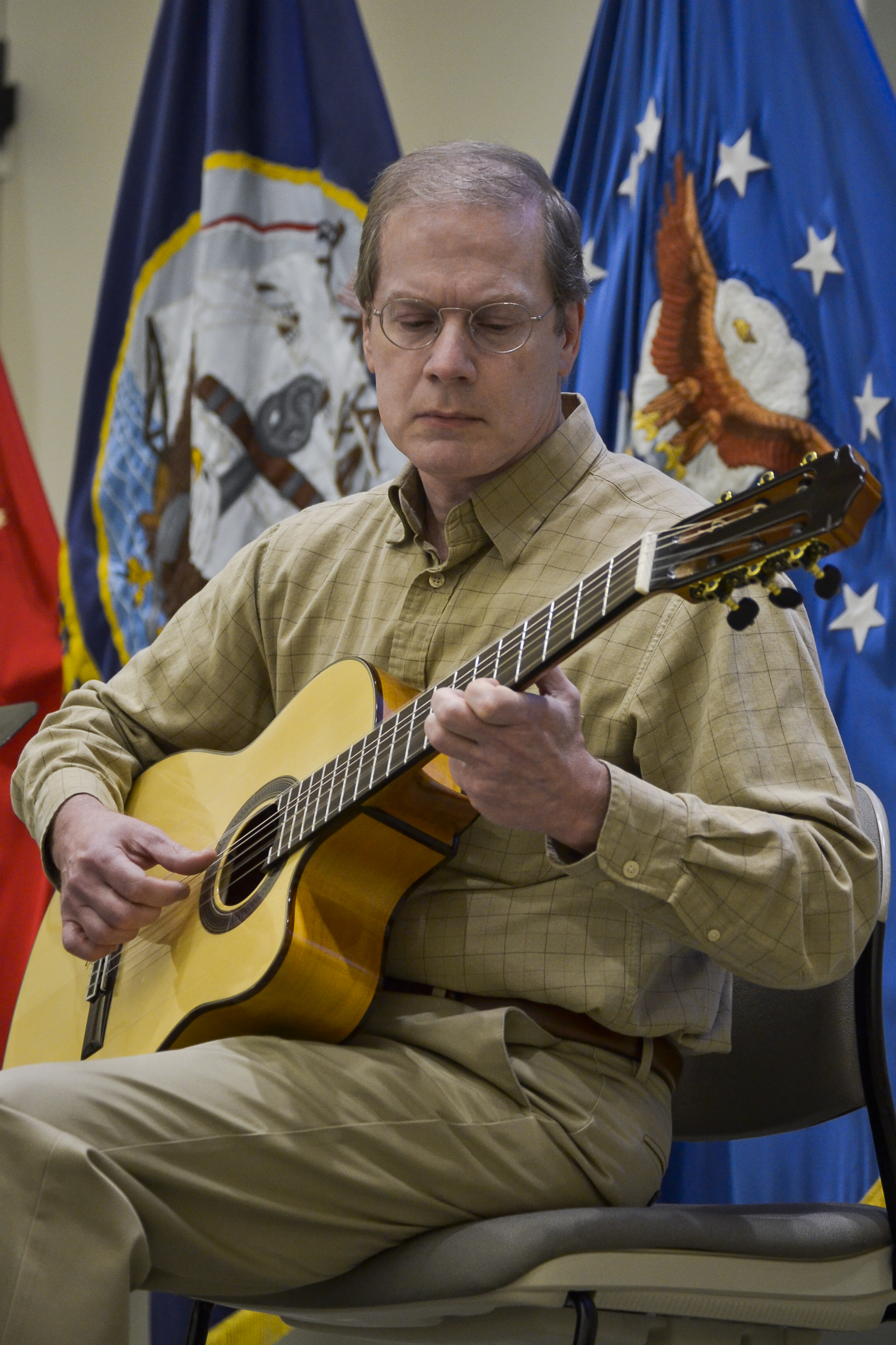 Raymond Smith, DLA Troop Support Clothing and Textile contract specialist, performs two short guitar selections written by Fernando Sor, a Spanish classical guitarist and composer, during the annual Hispanic Heritage Month celebration Sept. 25, 2019 in Philadelphia.